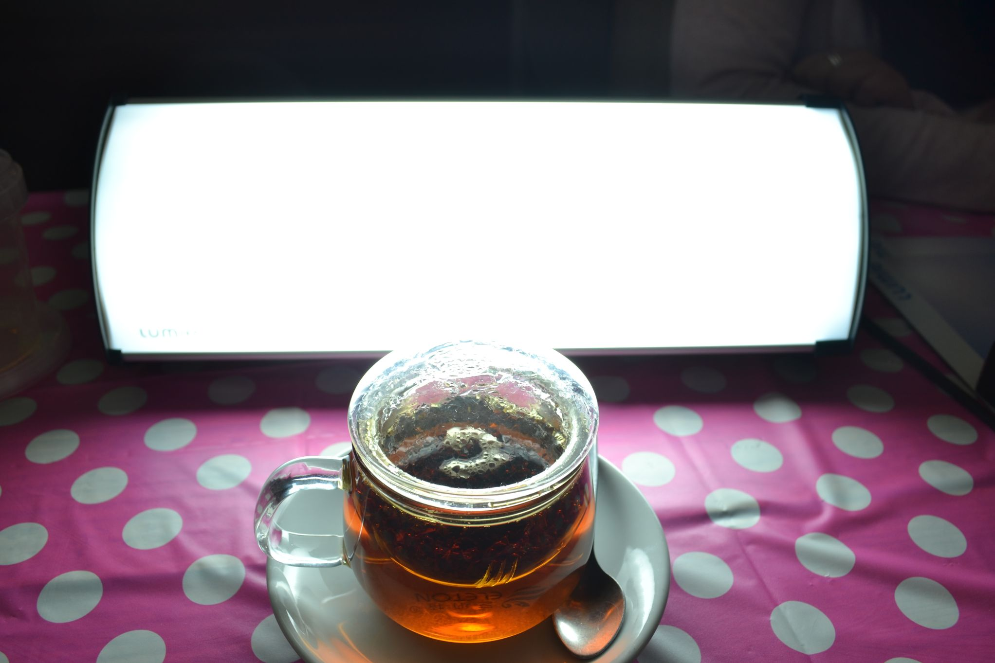 Lumie Brightspark SAD light with a cup of tea placed in front of it | Lightopia